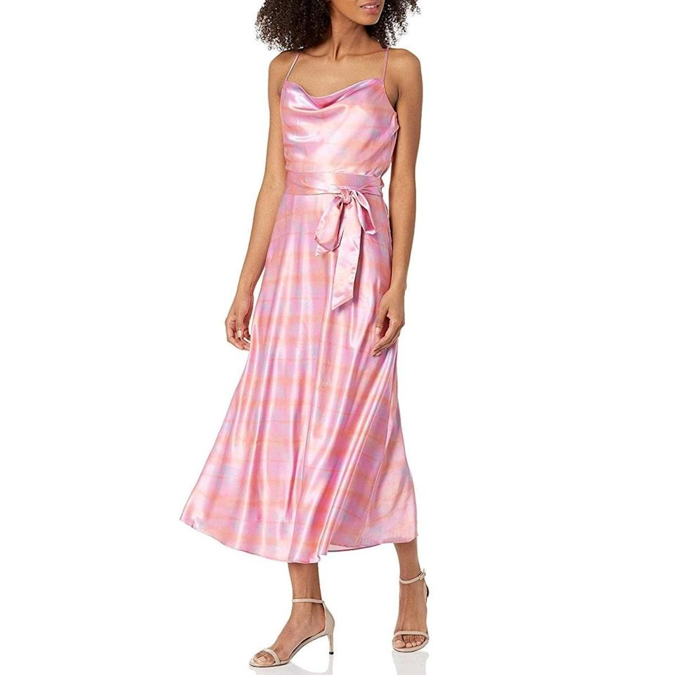 """Sometimes all it takes is a belt to turn a <a href=""""https://www.glamour.com/gallery/best-slip-dresses?mbid=synd_yahoo_rss"""" rel=""""nofollow noopener"""" target=""""_blank"""" data-ylk=""""slk:daytime slip dress"""" class=""""link rapid-noclick-resp"""">daytime slip dress</a> into an evening ensemble. Tie a big butterfly bow in the front or leave the tails swaying in the back, depending on your mood. $248, Amazon. <a href=""""https://www.amazon.com/LIKELY-Womens-Vittoria-Dress-Violet/dp/B091HZB22B"""" rel=""""nofollow noopener"""" target=""""_blank"""" data-ylk=""""slk:Get it now!"""" class=""""link rapid-noclick-resp"""">Get it now!</a>"""