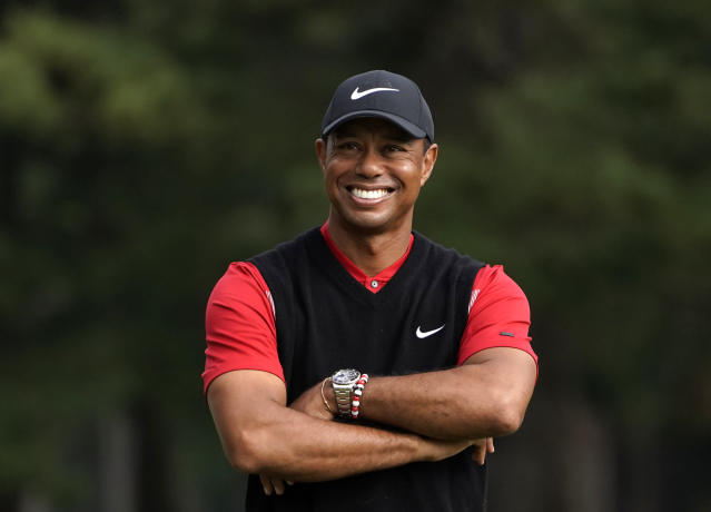 Tiger Woods of the United States smiles during a winner's ceremony after winning the Zozo Championship PGA Tour at the Accordia Golf Narashino country club in Inzai, east of Tokyo, Japan, Monday, Oct. 28, 2019. (AP Photo/Lee Jin-man)