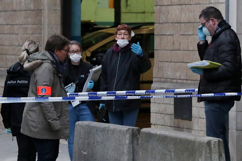 Police investigators work outside the police headquarters after a policeman was stabbed in Brussels: REUTERS