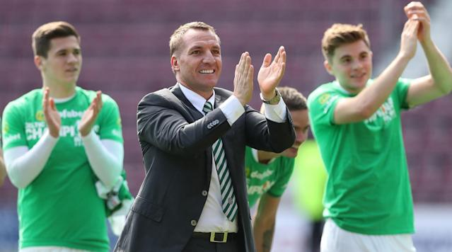 GLASGOW, Scotland (AP) - Celtic clinched a sixth straight Scottish Premiership title on Sunday with eight games to spare, reinforcing the Glasgow club's complete supremacy of the domestic game.