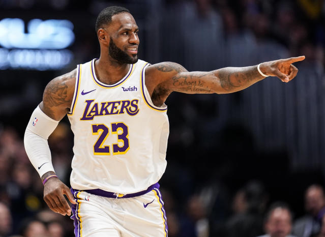 LeBron James briefly forgot the rules of basketball on Wednesday — and got away with it. (AP/Jack Dempsey)