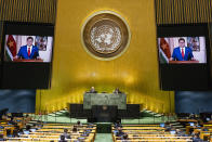 In this photo provided by the United Nations, the President of the Republic of Suriname, Chandrikapersad Santokhi's pre-recorded message is played during the 75th session of the United Nations General Assembly, Wednesday, Sept. 23, 2020, at U.N. headquarters. The U.N.'s first virtual meeting of world leaders started Tuesday with pre-recorded speeches from some of the planet's biggest powers, kept at home by the coronavirus pandemic that will likely be a dominant theme at their video gathering this year. (Rick Bajornas/UN Photo via AP)