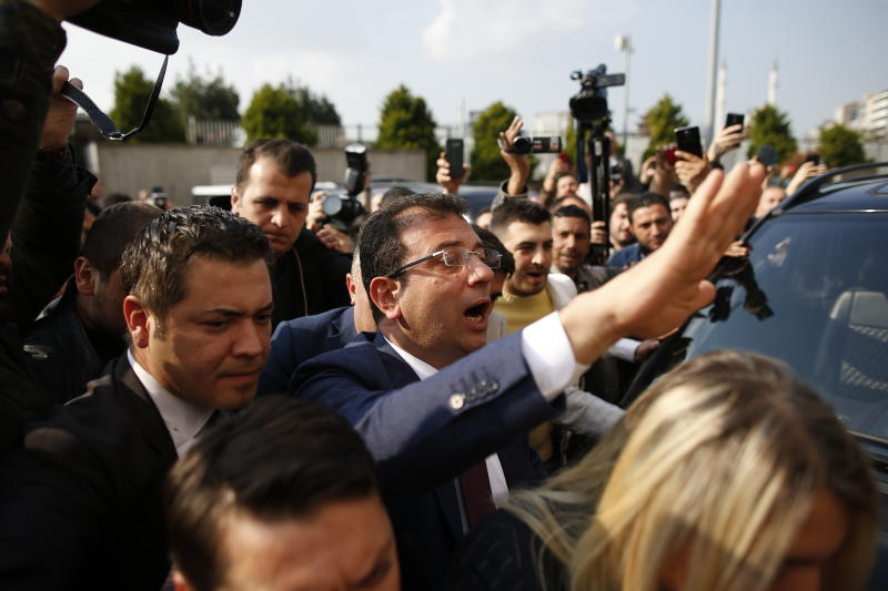 Ekrem Imamoglu, centre, of the opposition Republican People's Party (CHP) mayoral candidate in Istanbul, arrives to receive a certificate confirming his win by a slim margin against ruling party's candidate Binali Yildirim, in Istanbul, Turkey, Wednesday, April 17, 2019. Authorities have confirmed that Imamoglu won the mayoral election in Istanbul, ending nearly three weeks of recounts, although Turkey's top electoral body, has yet to consider a ruling party request for the vote in Istanbul to be invalidated.(AP Photo/Emrah Gurel)
