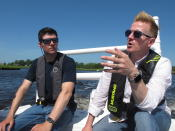 In this June 29, 2021 photo, Scott Stueber, left, a biologist with the New Jersey Department of Environmental Protection, and Shawn LaTourette, right, the department's commissioner discuss the state's program to collect shells from restaurants in Atlantic City and place them into the Mullica River in Port Republic, N.J. while aboard a boat in Port Republic. (AP Photo/Wayne Parry)
