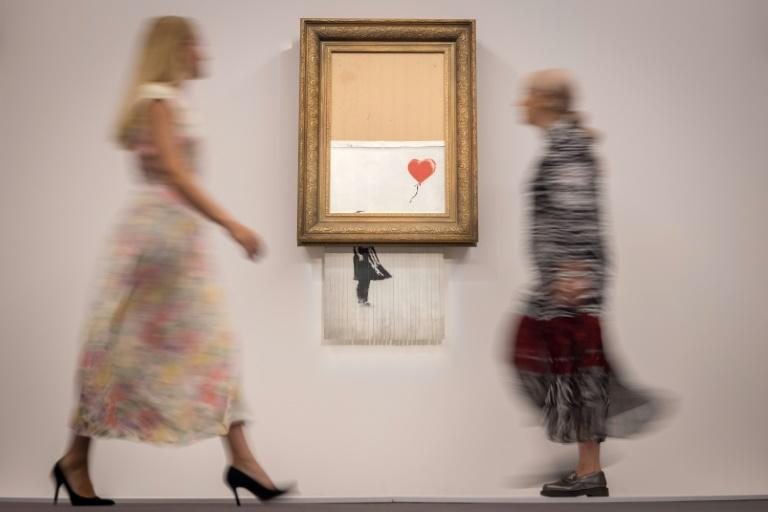 Banksy's partially shredded canvas is expected to sell for between £4-6 million ($6-8 million, 5-7 million euros) (AFP/Tolga Akmen)