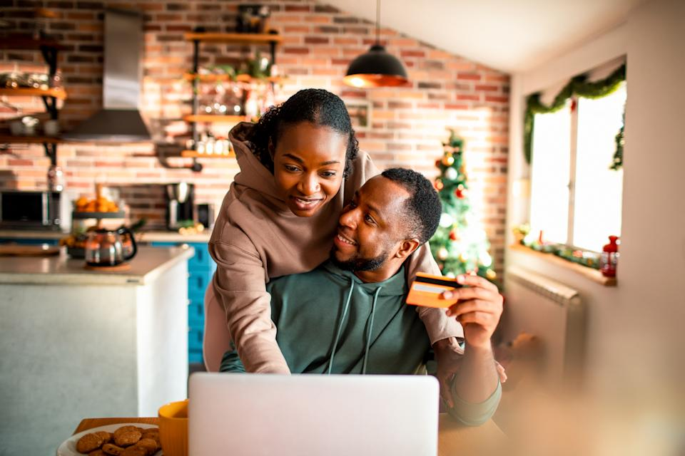 Close up of a young couple doing online Christmas shopping