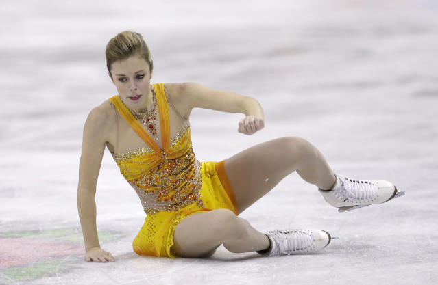 Ashley Wagner falls to the ice during the senior ladies free skate program at the U.S. figure skating championships, Saturday, Jan. 26, 2013, in Omaha, Neb. (AP Photo/Charlie Neibergall)