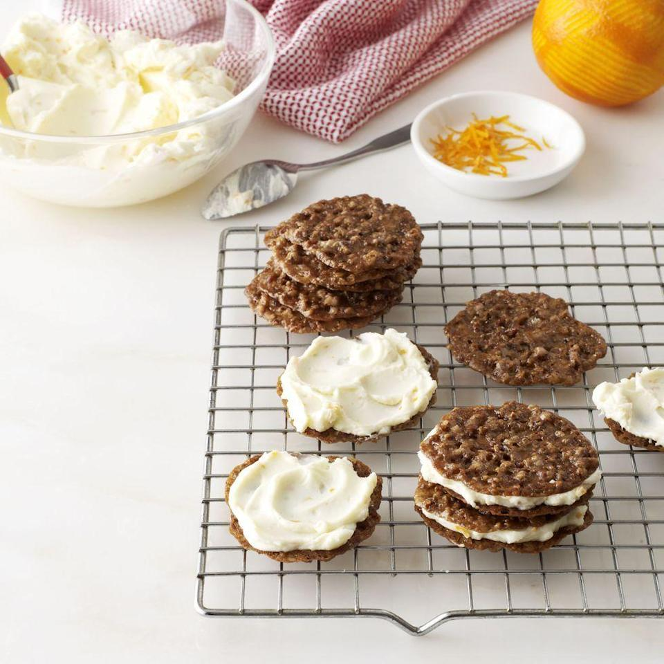 """<p>Crunchy, buttery pecan cookies paired with a creamy, citrus-flecked filling makes a heavenly dessert.</p><p><em><a href=""""https://www.goodhousekeeping.com/food-recipes/a14588/pecan-lace-cookie-sandwiches-recipe-wdy1213/"""" rel=""""nofollow noopener"""" target=""""_blank"""" data-ylk=""""slk:Get the recipe for Pecan Lace Cookie Sandwiches »"""" class=""""link rapid-noclick-resp"""">Get the recipe for Pecan Lace Cookie Sandwiches »</a></em></p>"""