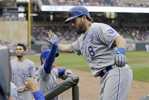 Kansas City Royals' Mike Moustakas is greeted in the dugout by manager Ned Yost after a two-run home off Minnesota Twins pitcher P.J. Walters in the third inning of a baseball game Friday, June 28, 2013, in Minneapolis. (AP Photo/Jim Mone)