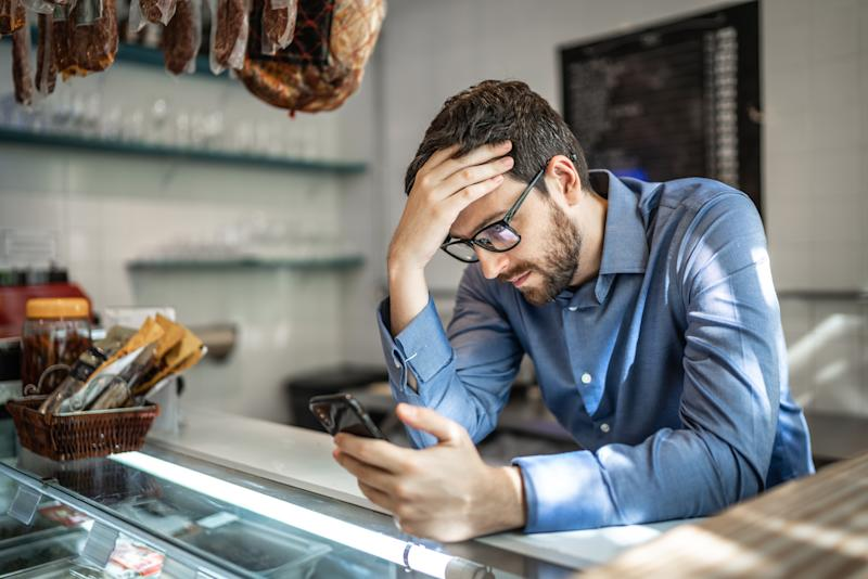 Worried small business owner. Credit: Getty.