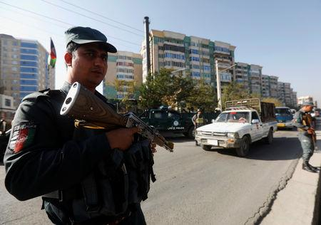 Afghan policemen stand guard at a checkpoint a day before parliamentary elections in Kabul, Afghanistan October 19, 2018. REUTERS/Omar Sobhani
