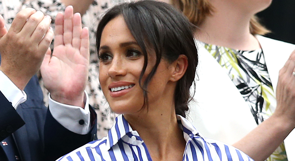 Meghan Markle has been seen in another chic striped shirt, proving it's one of her royal style staples. [Photo: Getty]