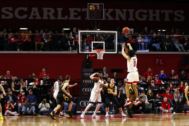 Rutgers guard Geo Baker (0) makes a three point basket during the second half of an NCAA college basketball game against Iowa, Saturday, Feb. 16, 2019, in Piscataway, N.J. Iowa won 71-69. (AP Photo/Adam Hunger)