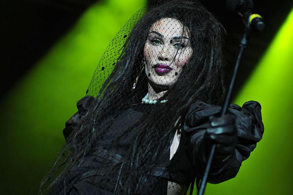 """Pete Burns was a gender-bending new wave and reality TV star, best known for fronting Dead or Alive. Dead or Alive had a run of pop hits in the 1980s, most notably 1985′s """"You Spin Me Round (Like a Record)."""" Burns died from a cardiac arrest on Oct. 23. He was 57 years old. (Photo: Redferns)"""