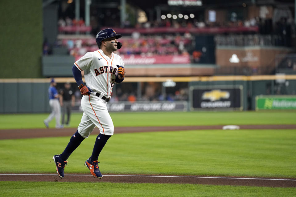 Houston Astros' Jose Altuve runs the bases after hitting a home run against the Texas Rangers during the first inning of a baseball game Wednesday, June 16, 2021, in Houston. (AP Photo/David J. Phillip)