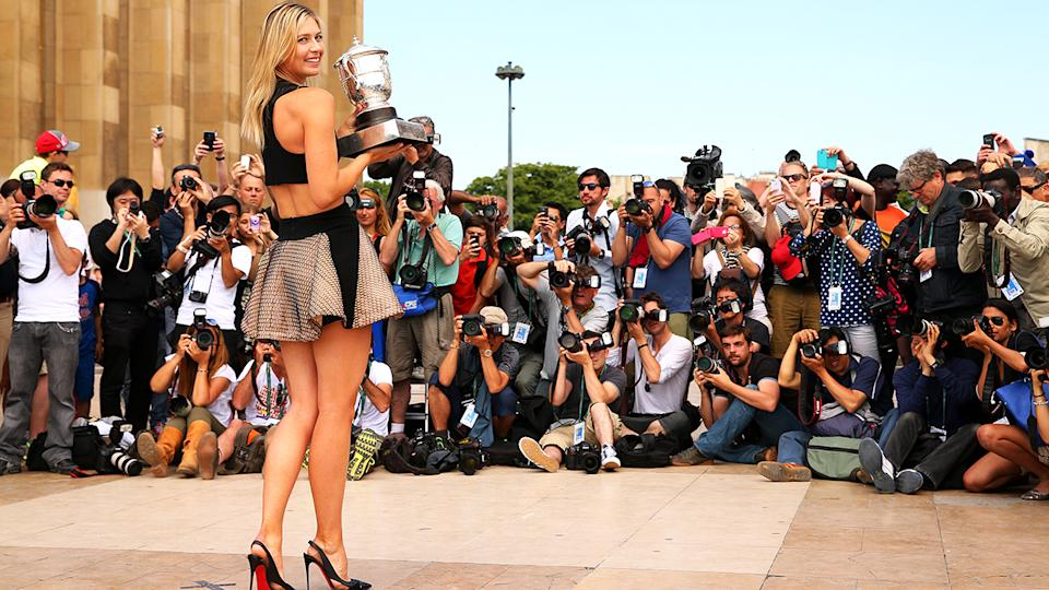 Maria Sharapova, pictured here posing with the Coupe Suzanne Lenglen trophy after winning the French Open in 2014.