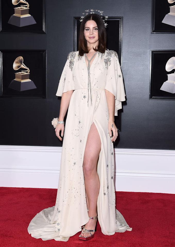 <p>Erm, we may as well stop the list already. How incredible was Lana Del Ray's whimsical thigh-high split dress by Gucci? And just when you thought the aesthetic couldn't be any more heavenly, the singer accessorised the look with a bejewelled halo. <em>[Photo: Getty]</em> </p>