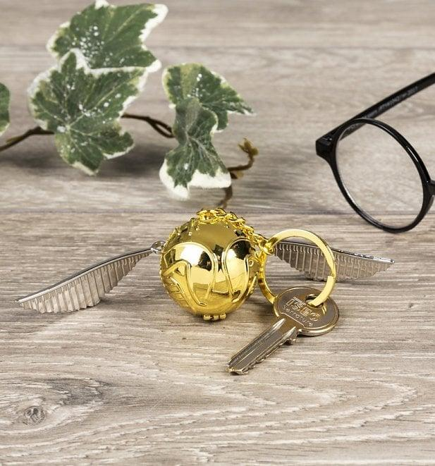 <p>This <span> Golden Snitch Keychain </span> ($13) opens at the close (by popping in half!).</p>
