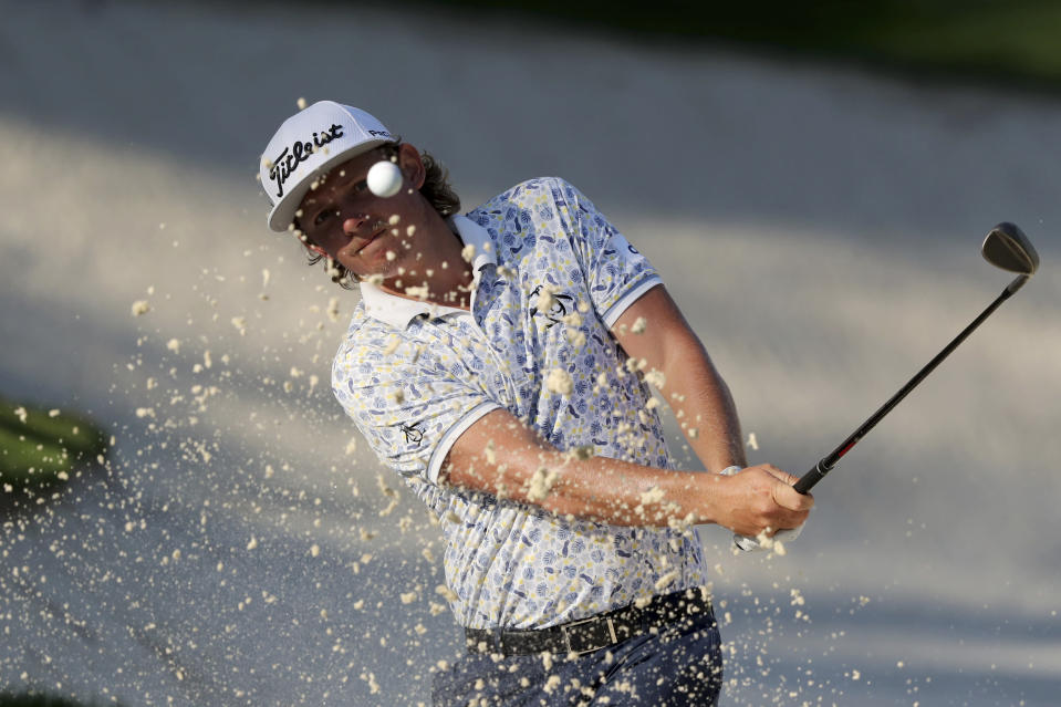Cameron Smith hits out of the bunker on the 10th hole during the third round of the Masters Saturday, Nov. 14, 2020, in Augusta, Ga. (Curtis Compton/Atlanta Journal-Constitution via AP)