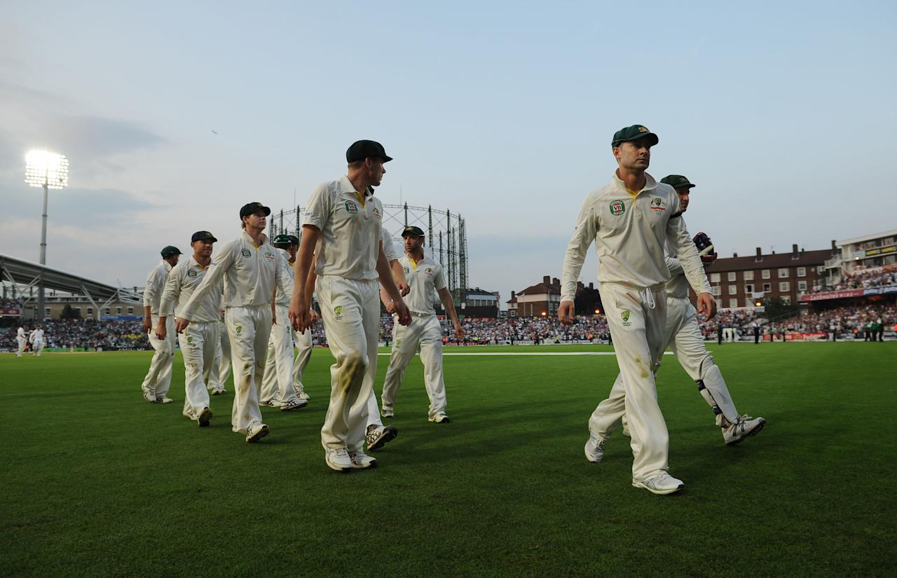 Australia's captain Michael Clarke leads his players off after bad light stops play during day five of the Fifth Investec Ashes Test match at The Kia Oval, London.