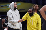 Brooklyn Nets forward Kevin Durant, left, and guard James Harden stand near the bench during the first half of a preseason NBA basketball game against the Los Angeles Lakers Sunday, Oct. 3, 2021, in Los Angeles. (AP Photo/Mark J. Terrill)