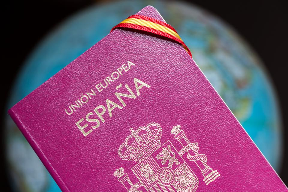 Spanish passport, spanish flag and earth globe