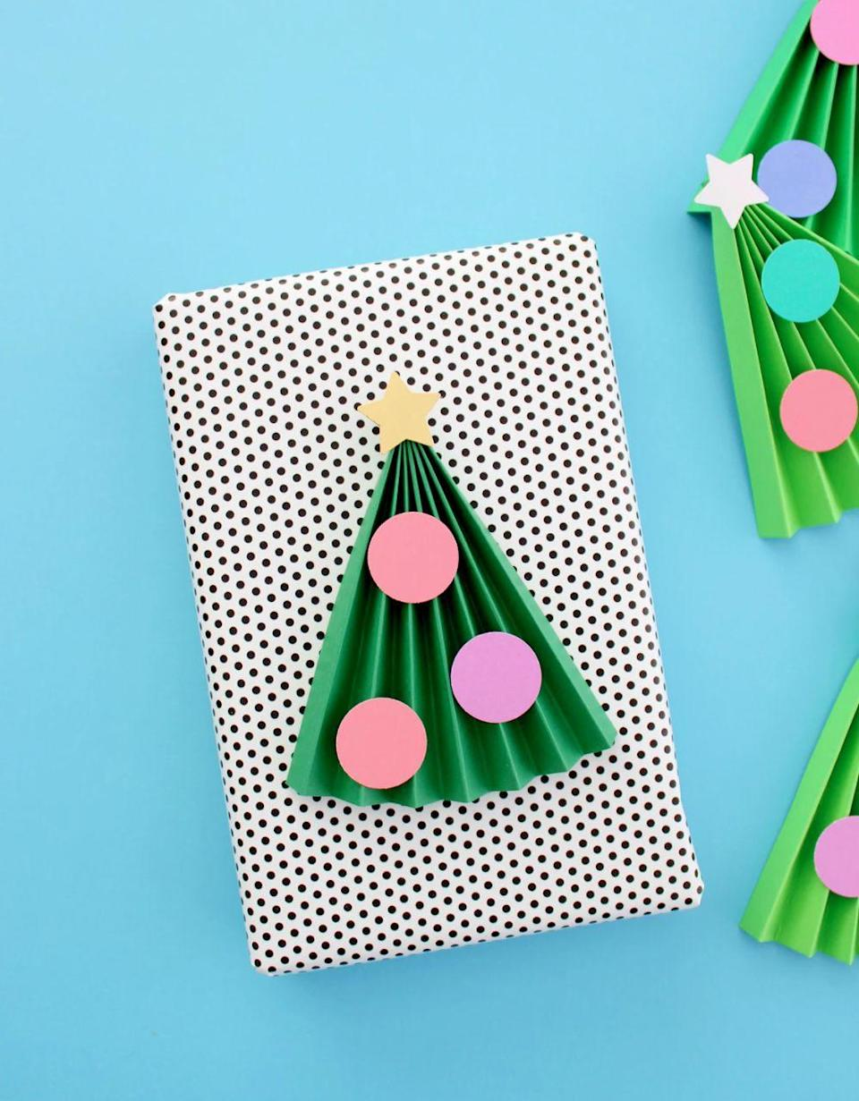 "<p>This folded paper project is easy enough to involve the littlest crafters. Fold green paper accordion style to create the look of Christmas trees, adding paper ornaments to finish the look.</p><p><em><a href=""https://www.whitehousecrafts.net/post/2019/11/24/5-minute-kids-accordion-christmas-tree-craft"" rel=""nofollow noopener"" target=""_blank"" data-ylk=""slk:Get the tutorial at White House Crafts»"" class=""link rapid-noclick-resp"">Get the tutorial at White House Crafts»</a></em><br></p>"