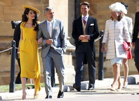 Amal Clooney and George Clooney arrive at the wedding of Prince Harry to Ms Meghan Markle at St George's Chapel, Windsor Castle in Windsor, Britain, May 19, 2018. Chris Jackson/Pool via REUTERS
