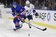 New York Rangers' Brady Skjei (76) fights for control of the puck with Toronto Maple Leafs' William Nylander (88) during the first period of an NHL hockey game Friday, Dec. 20, 2019, in New York. (AP Photo/Frank Franklin II)