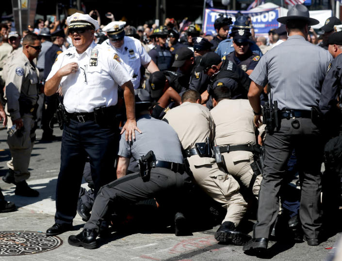 <p>Police hold a protester to the ground during demonstration, July 20, 2016, in Cleveland, during the third day of the Republican convention. (Photo: John Minchillo/AP)</p>