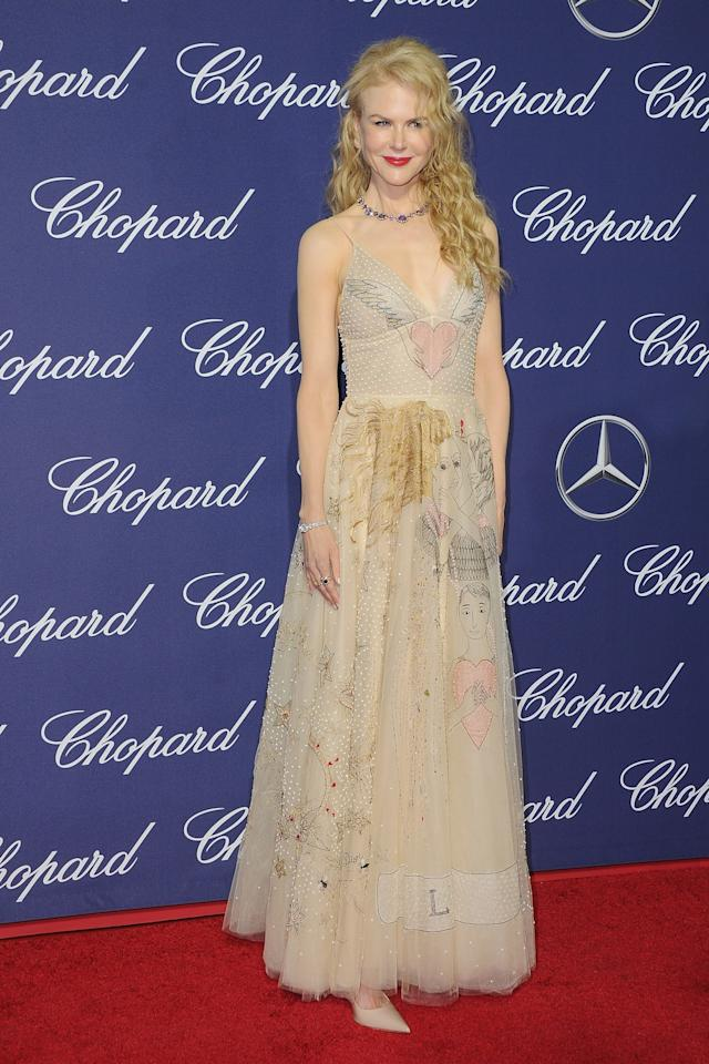<p>The Australian actress, who was honored with the International Star Award for her role in <em>Lion</em>, wore a nude Dior dress that matched her pale skin. The gown featured embellishments and unique drawings. She accessorized with a bejeweled necklace, a bold lip, and loose waves that framed her face. (Photo: Getty Images) </p>