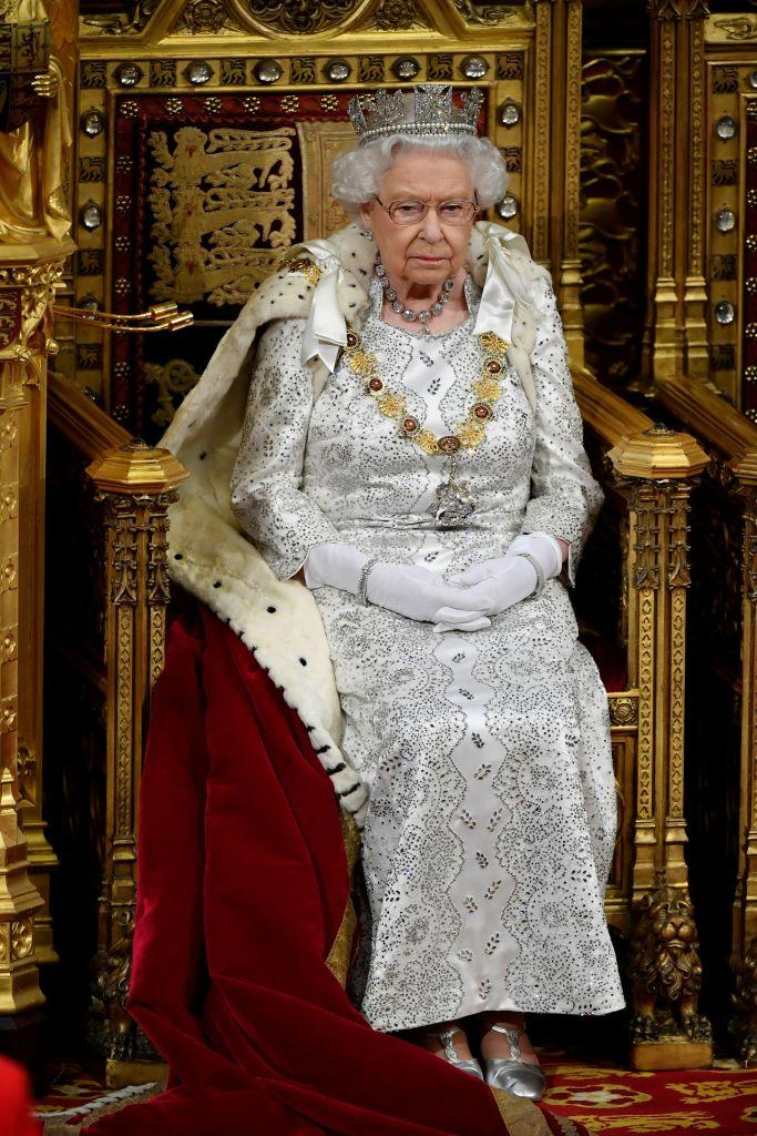 Queen Elizabeth looked amazing in a beautiful silver gown and matching silver heels [Photo: Getty]