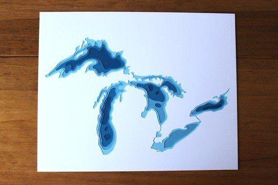 """Get it <a href=""""https://www.etsy.com/listing/65455246/the-great-lakes-original-8-x-10-papercut?ref=shop_home_active_8"""" target=""""_blank"""">here</a>."""