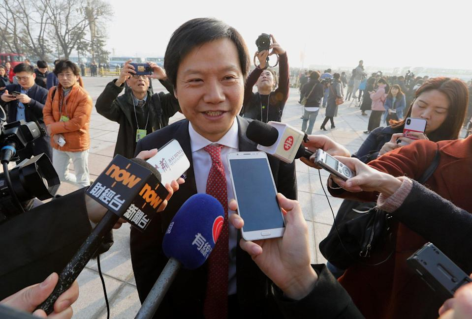 Xiaomi Corp founder and chief executive Lei Jun says that he found a connection between smartphones and smart electric vehicles. Photo: SCMP