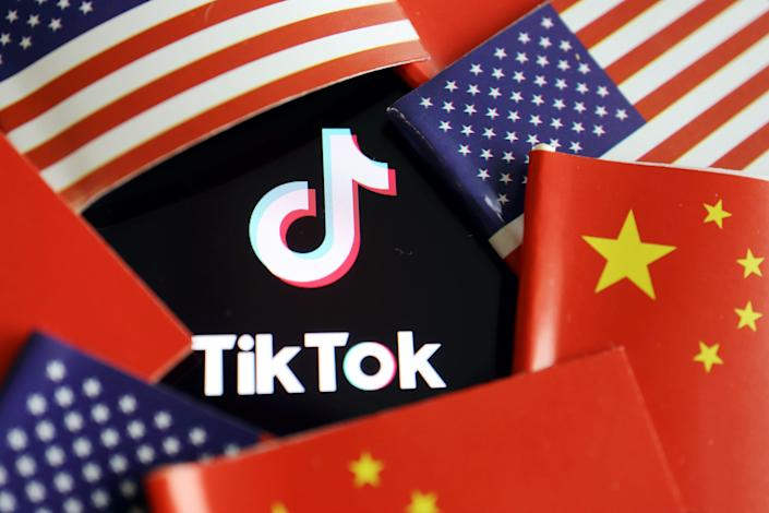 China and US flags are seen near a TikTok logo in this illustration picture taken July 16, 2020.