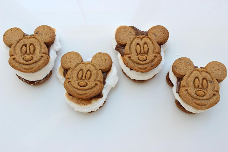 Four s'mores made with Mickey Mouse-shaped cookies.