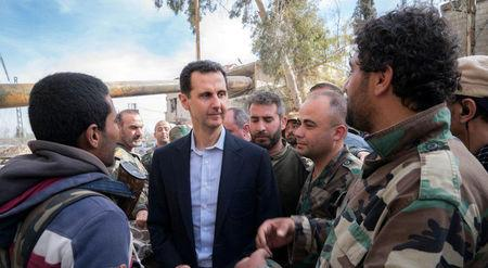 Syrian President Bashar al-Assad meets with Syrian army soldiers in eastern Ghouta
