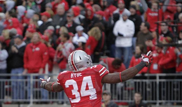 Ohio State running back Carlos Hyde celebrates his touchdown against Iowa during the fourth quarter of an NCAA college football game Saturday, Oct. 19, 2013, in Columbus, Ohio. Ohio State beat Iowa 34-24. (AP Photo/Jay LaPrete)