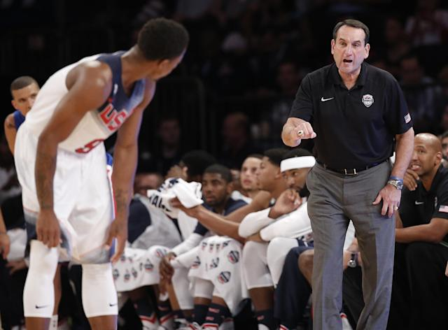U.S. coach Mike Krzyzewski calls to guard DeMar DeRozan (9) in the first half of an exhibition basketball game against the Dominican Republic at Madison Square Garden in New York, Wednesday, Aug. 20, 2014. (AP Photo/Kathy Willens)