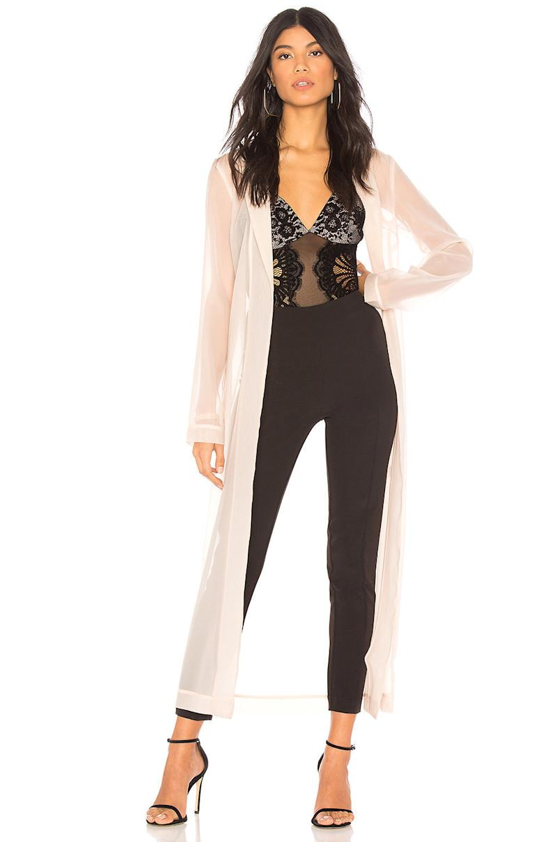 "<a href=""http://www.revolve.com/chrissy-teigen-x-revolve-muse-duster/dp/CTEI-WO1/?d=Womens&page=1&lc=17&itrownum=6&itcurrpage=1&itview=01&plpSrc=%2Fr%2FBrands.jsp%3FaliasURL%3Dchrissy-teigen%2Fbr%2F11bc37%26%26s%3Db%26c%3DChrissy%2BTeigen%26sortBy%3Dprice"" target=""_blank"">Chrissy Teigen x Revolve Muse Duster</a>, $188.  (Revolve)"