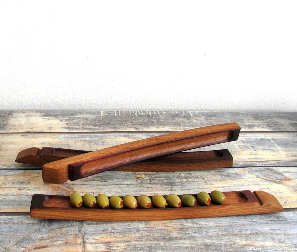 <p>A wooden <span>olive boat</span> ($28) is just what your favorite hostess with the mostest needs. </p>