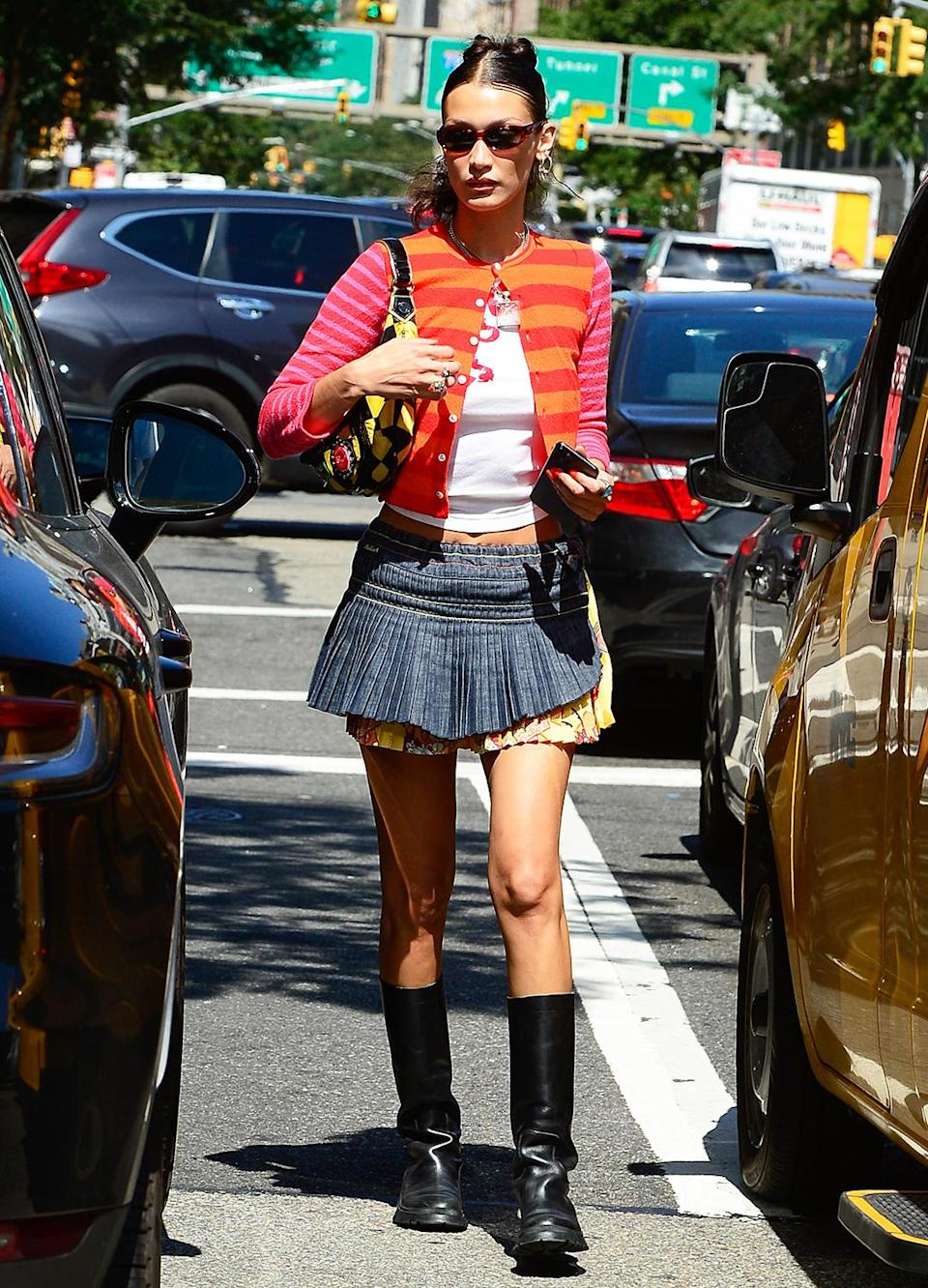<p>Bella Hadid turns heads in a colorful ensemble as she weaves through the streets of Soho.</p>