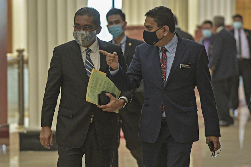 Minister in the Prime Minister's Department Datuk Takiyuddin Hassan (left) is pictured in Parliament Kuala Lumpur August 27, 2020. — Picture by Shafwan Zaidon