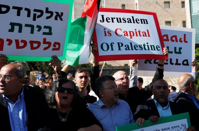 <p>Palestinians demonstrate outside the new U.S. embassy as the ceremony to inaugurate the controversial embassy in Jerusalem began on May 14, 2018. (Photo: Ahmad Gharabli/AFP/Getty Images) </p>
