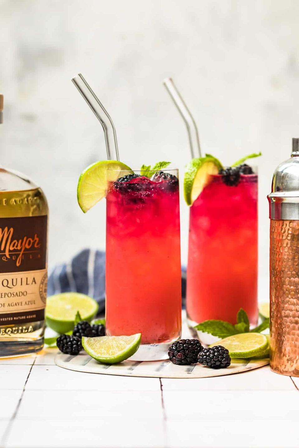 """<p>A hot day in Texas calls for an ice-cold paloma! This magenta drink is filled with rich flavor, and not to mention, a whole lot of tequila! Cheers to you, Texas!</p> <p><strong>Get the recipe</strong>: <a href=""""https://www.popsugar.com/buy?url=https%3A%2F%2Fwww.thecookierookie.com%2Fblackberry-paloma-recipe%2F&p_name=blackberry%20paloma&retailer=thecookierookie.com&evar1=yum%3Aus&evar9=47471653&evar98=https%3A%2F%2Fwww.popsugar.com%2Ffood%2Fphoto-gallery%2F47471653%2Fimage%2F47475203%2FTexas-Paloma&list1=cocktails%2Cdrinks%2Calcohol%2Crecipes&prop13=api&pdata=1"""" class=""""link rapid-noclick-resp"""" rel=""""nofollow noopener"""" target=""""_blank"""" data-ylk=""""slk:blackberry paloma"""">blackberry paloma</a></p>"""