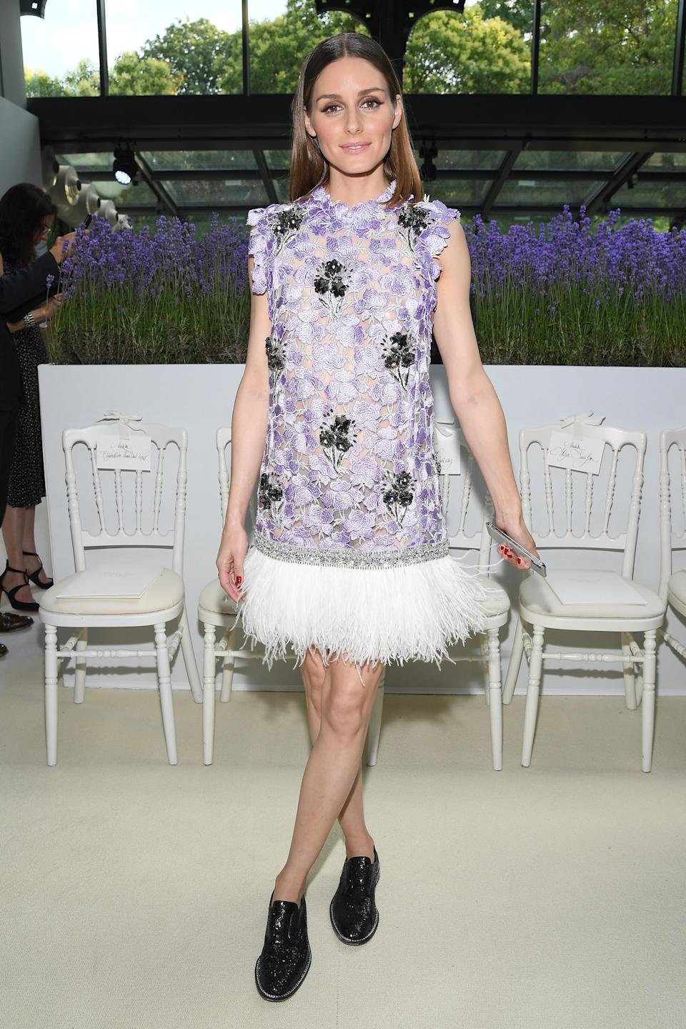 <p>Olivia Palermo donned a floral dress finished with a feathered hem for the Giambattista Valli haute couture show on 2 July in Paris. <em>[Photo: Getty] </em> </p>