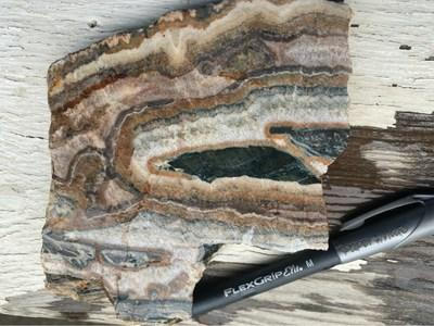 Figure 2B – Photograph of a rock sample collected from the Cyclone prospect showing well defined colloform banding and chalcedonic quartz in an epithermal-style vein reminiscent of a high-level environment (CNW Group/Talisker Resources Ltd)