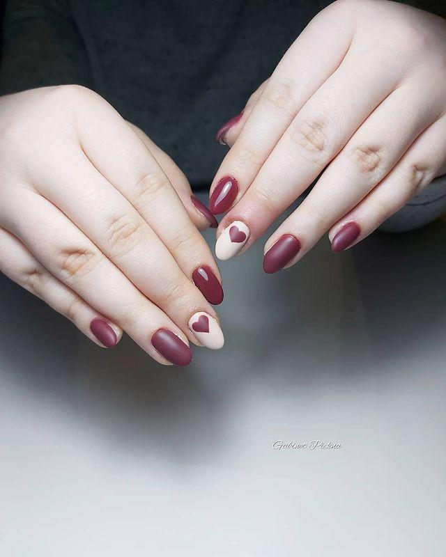 "<p>A deep burgundy shade still hits on the V Day theme without looking overly-girly. Add a coat of matte for even more edge, then balance it out with a heart-clad statement nail. </p><p><a href=""https://www.instagram.com/p/B7lqdzHFuWC/?utm_source=ig_embed&utm_campaign=loading"" rel=""nofollow noopener"" target=""_blank"" data-ylk=""slk:See the original post on Instagram"" class=""link rapid-noclick-resp"">See the original post on Instagram</a></p>"