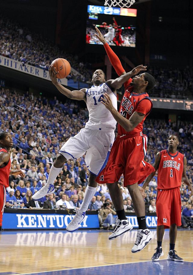 LEXINGTON, KY - FEBRUARY 18: Michael Kidd-Gilchrist #14 of the Kentucky Wildcats shoots the ball while defended by Aaron Jones #34 of the Ole Miss Rebels during the game at Rupp Arena on February 18, 2012 in Lexington, Kentucky. (Photo by Andy Lyons/Getty Images)