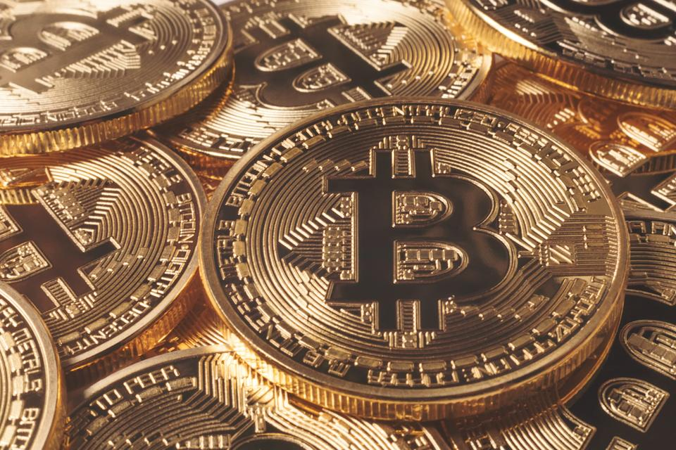 Not actual bitcoins. Bitcoin is software that forms a decentralized, peer-to-peer payment system with no central authority like the Federal Reserve or U.S. Treasury. (Photo: Getty Creative)